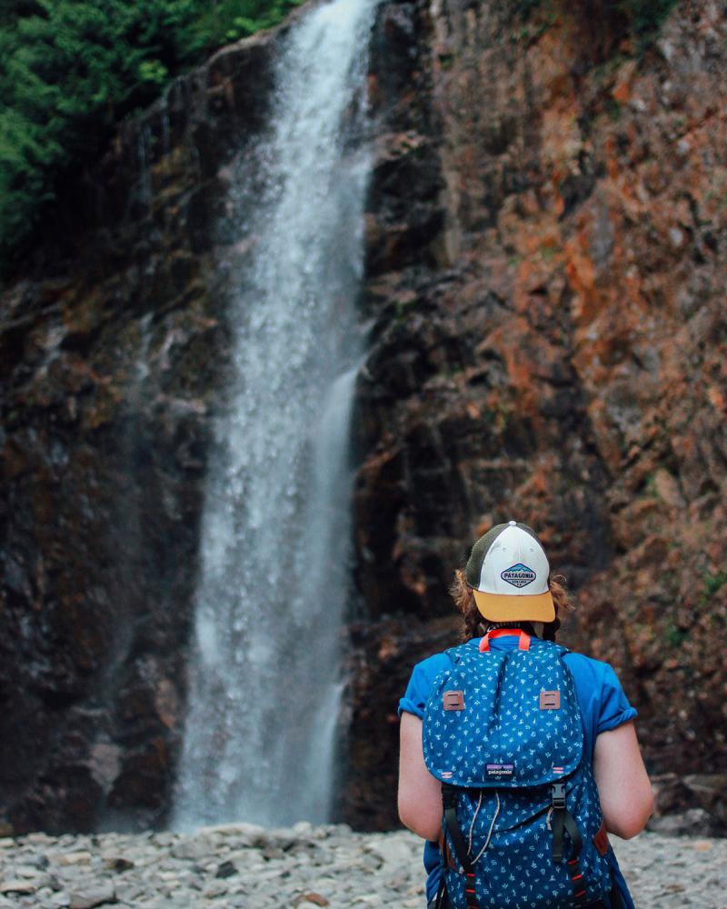 Emily Nina at a waterfall.