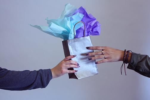 A friend giving a gift.