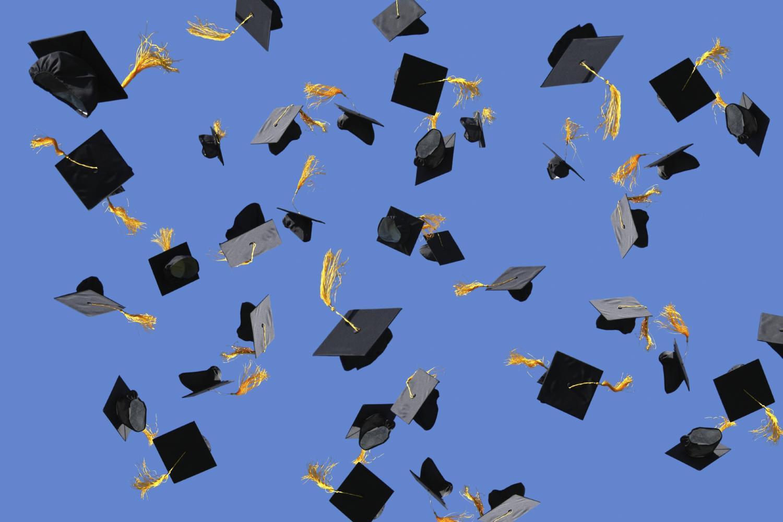 Graduation+caps+being+thrown+through+the+air.