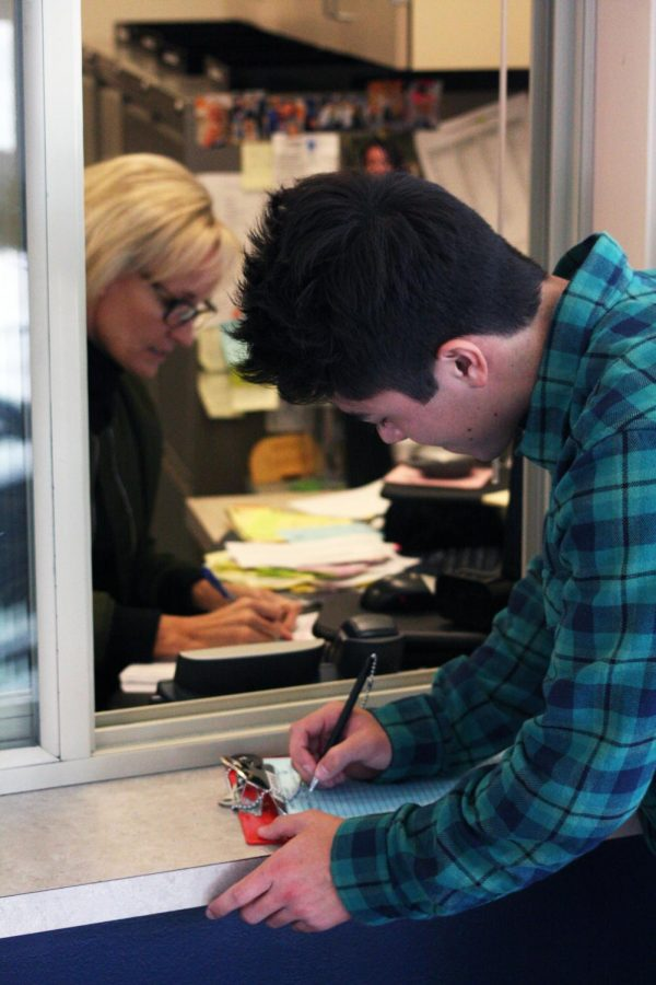 A student checking in at the attendance office.