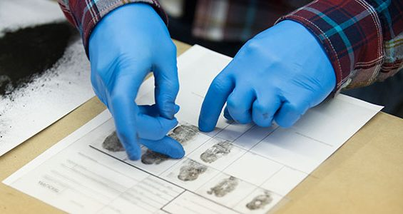 Students practicing doing fingerprinting. Credit: Marian University