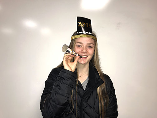 Maddie Seelhoff with a new years celebration hat on.