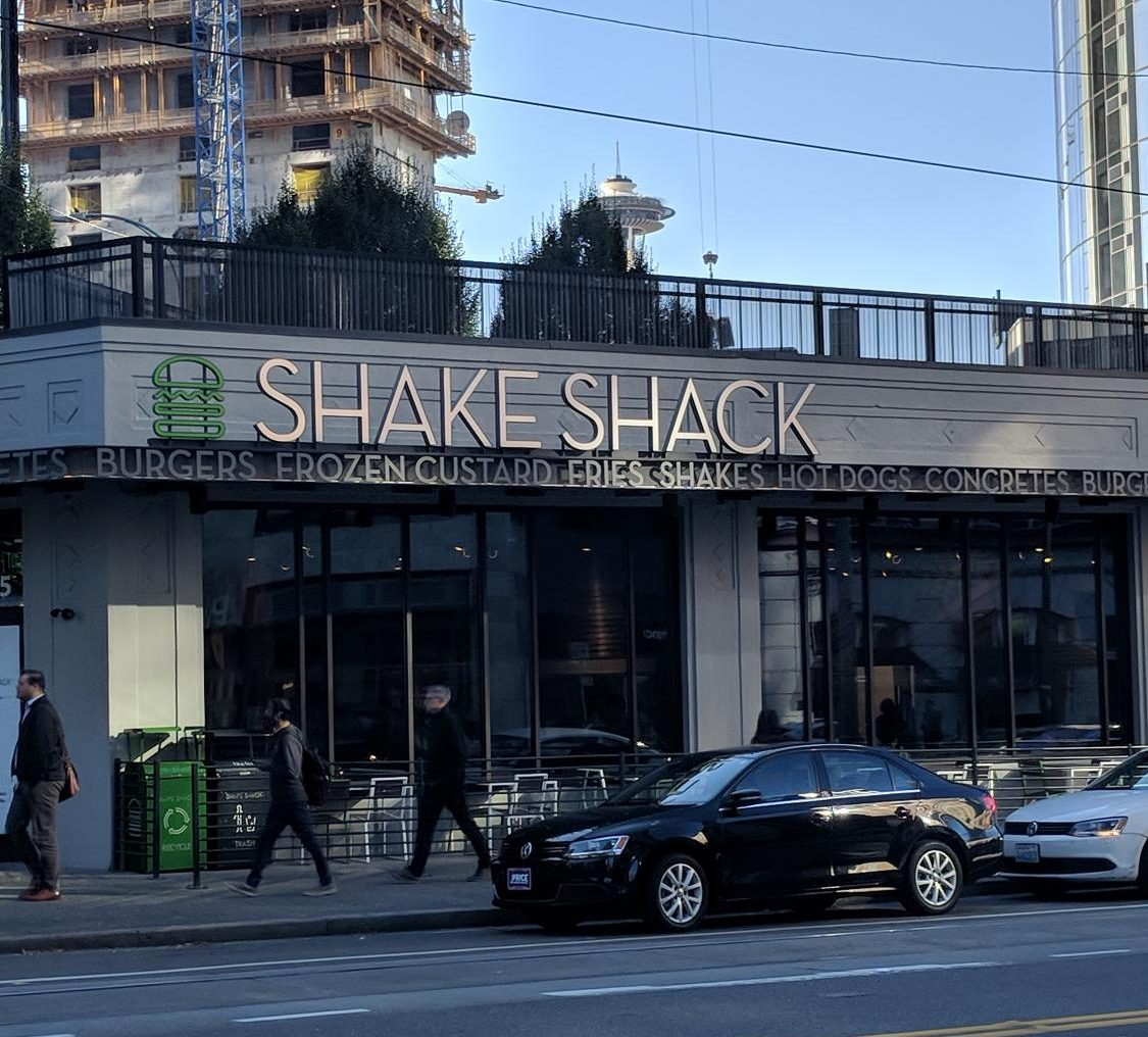 The new Shake Shack storefront with a view of the Space Needle.