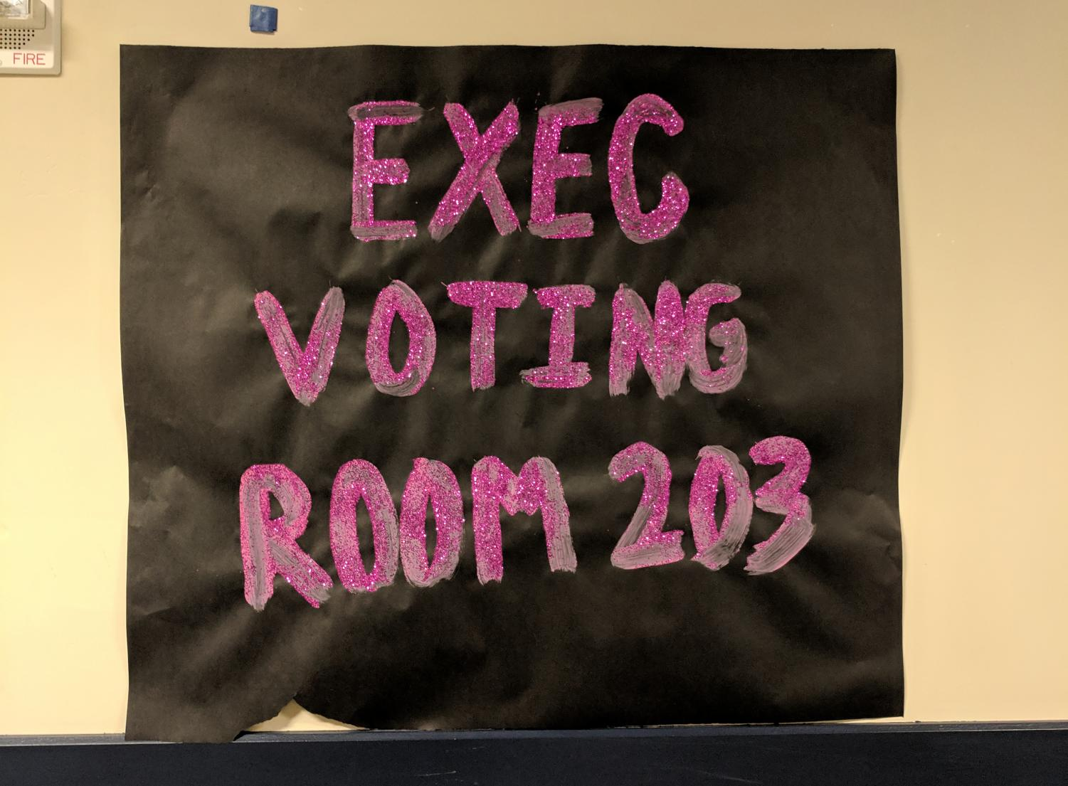 A poster for the voting center in room 203.