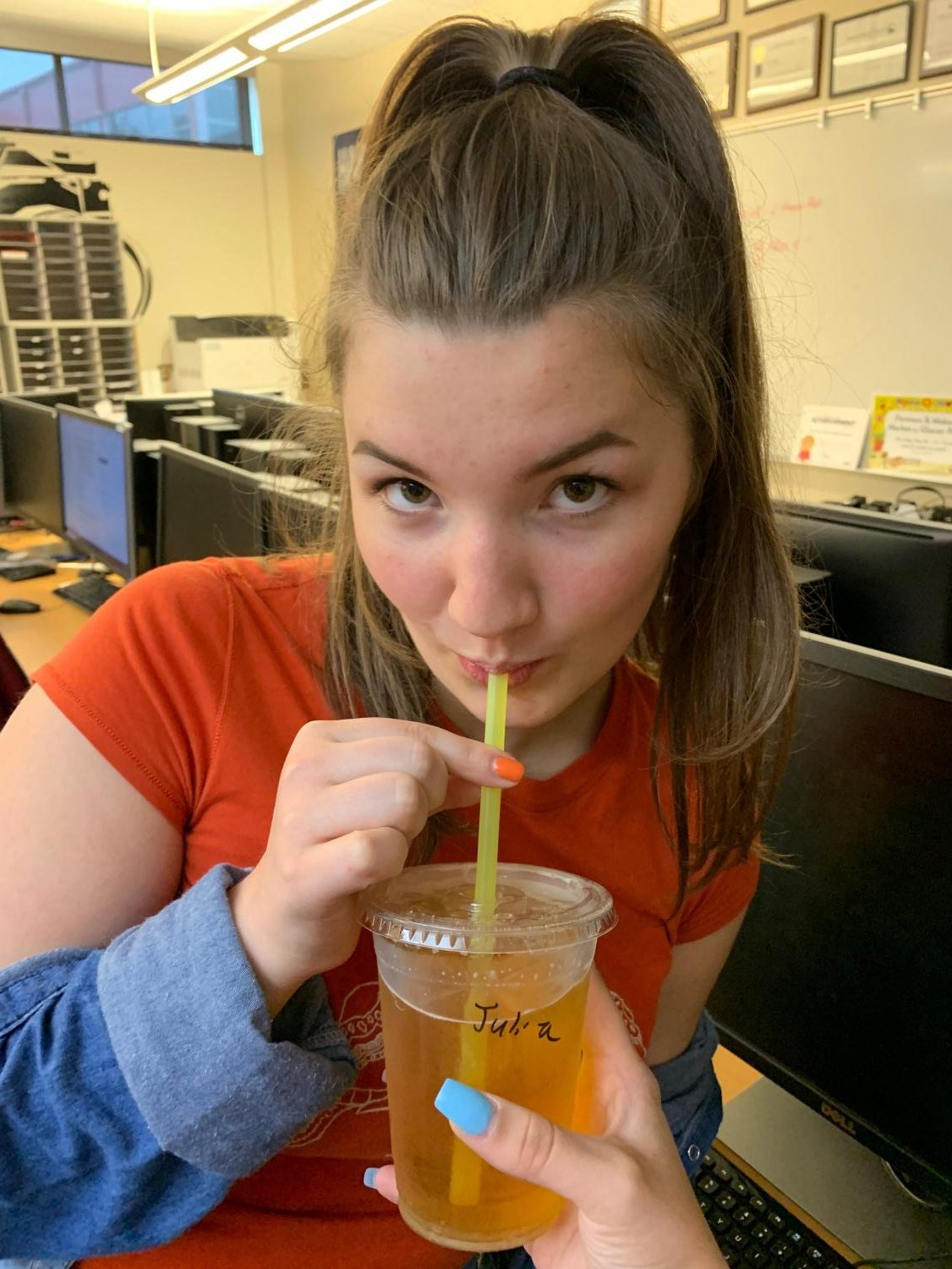 Sipping on a friend's Red Bull Italian Soda, senior Grace McManus stares at the camera.