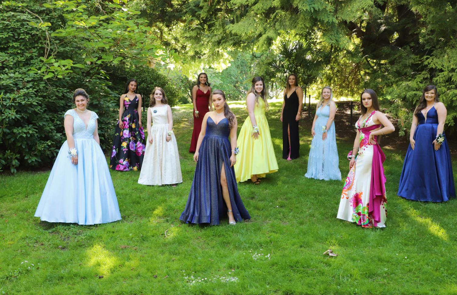 A group of girls pose in their unique dresses for prom pictures.
