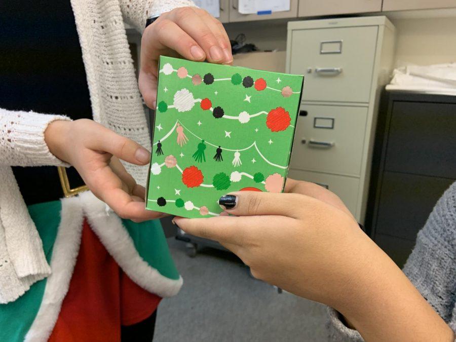 A student gives a teacher a present.