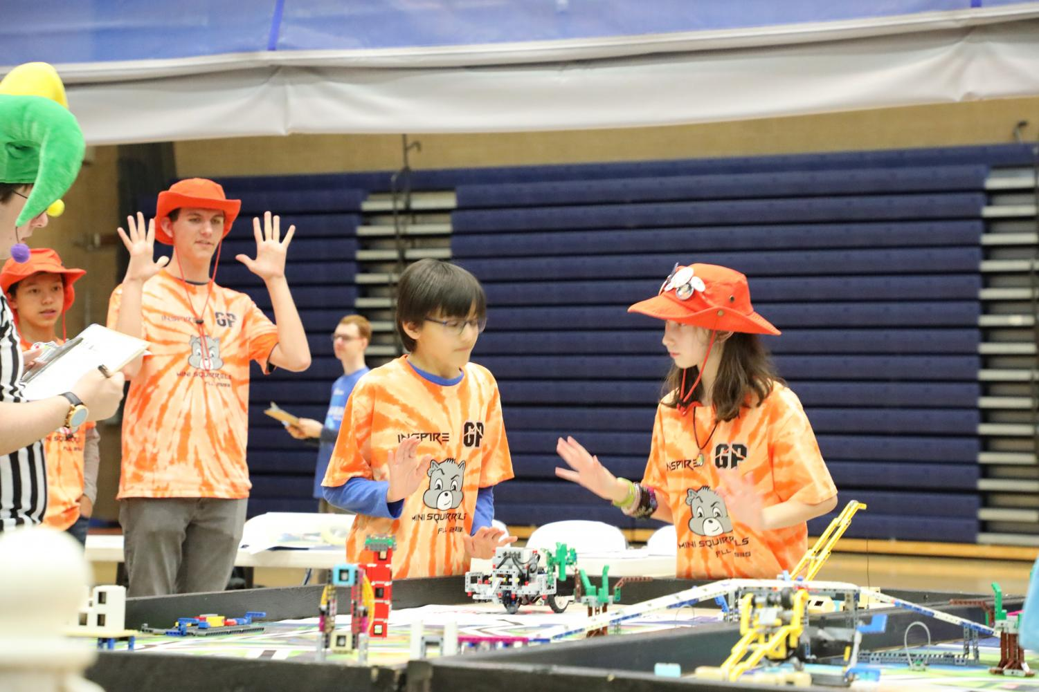Members of a team mentored by a Glacier Peak robotics student compete with their robot