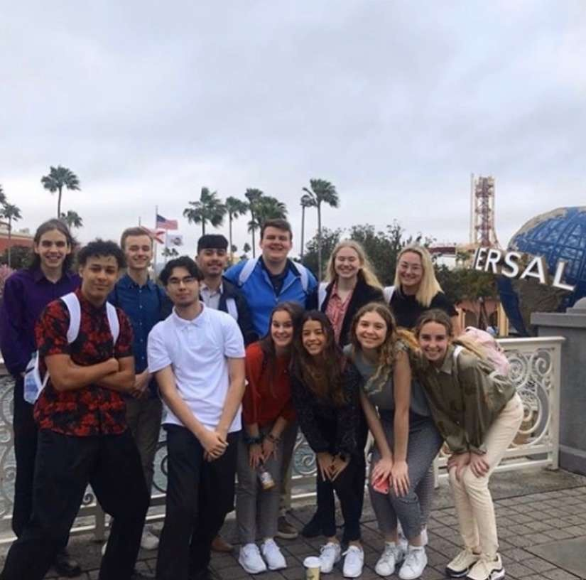 The+group+that+went+on+the+trip+pose+for+a+picture+in+front+of+the+Universal+Studios+globe.
