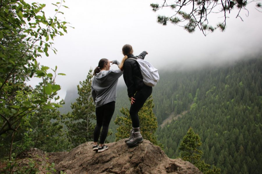 Students Jessica Delker and Amanda Riedlinger hiking on Mt. Si