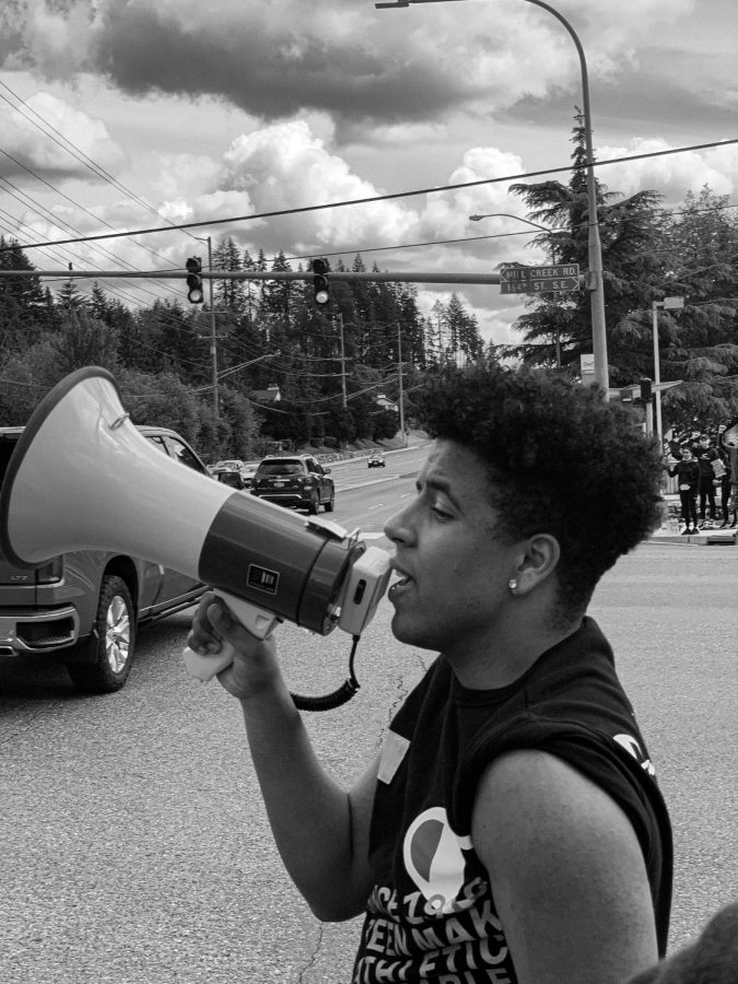 Keyshon Rife, leading chants to the protesters.