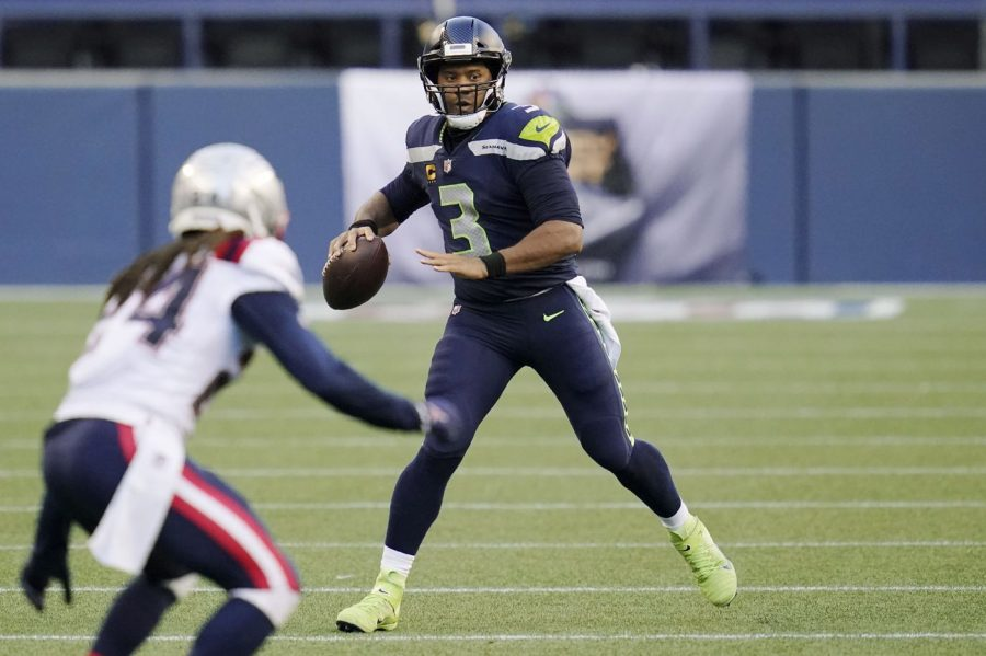 Russell+Wilson+stares+down+New+England+Patriots+cornerback+Stephon+Gilmore+in+a+Sep+20th+matchup.+The+Seahawks+went+on+to+win+35-30.