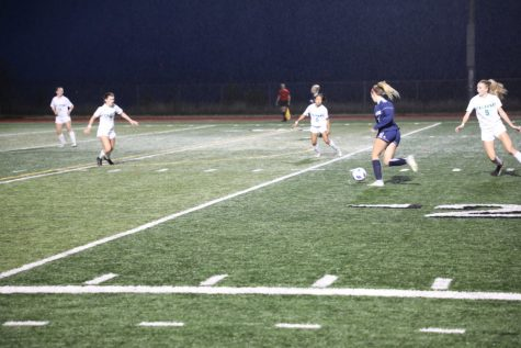 Ryann Reynolds sets up to bury the opening goal of the match